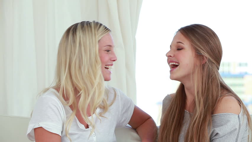 two-girls-chatting-and-laughing