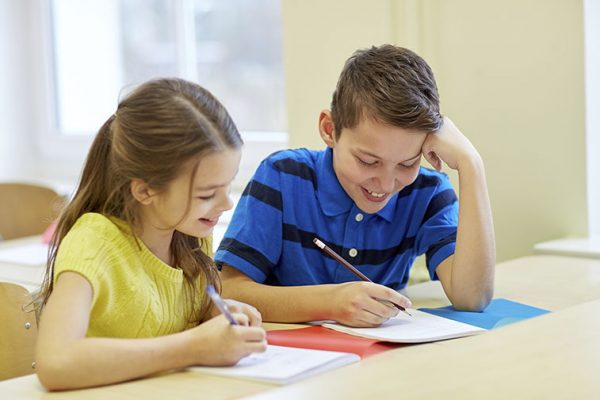 children-writing-at-home
