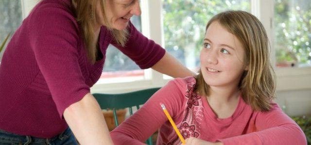 teacher-helping-a-student-solve-math-problems