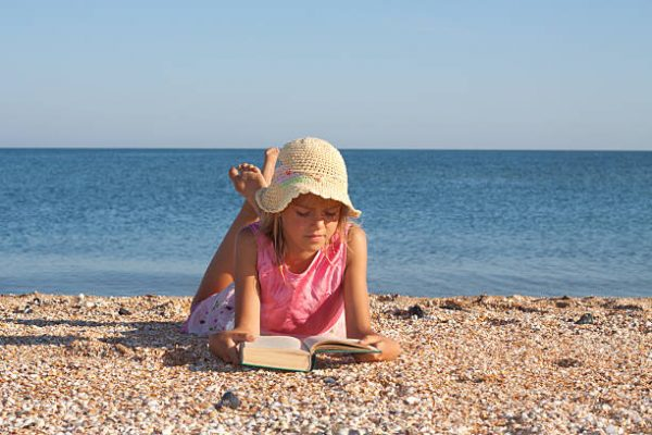 girl-reading-on-the-beach