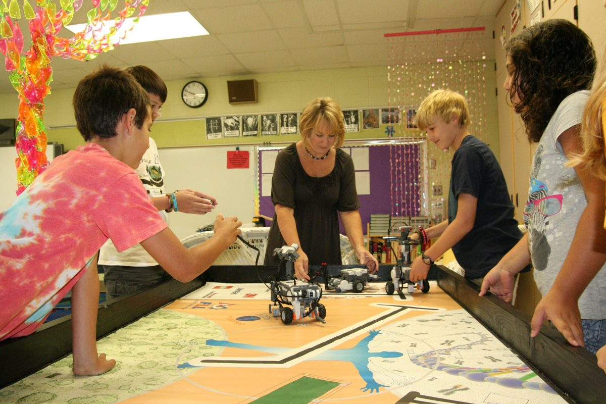 teacher-and-students-working-on-project