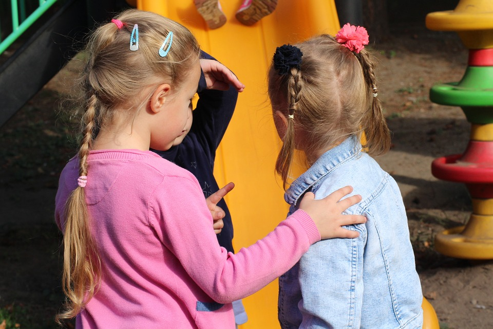 girls-having-conversation-playground