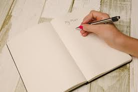 woman-writing-in-a-planner