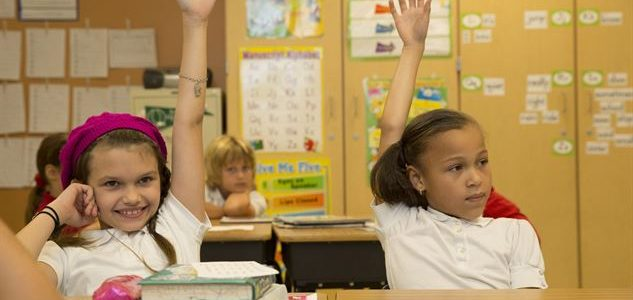 children-raising-hands-in-class