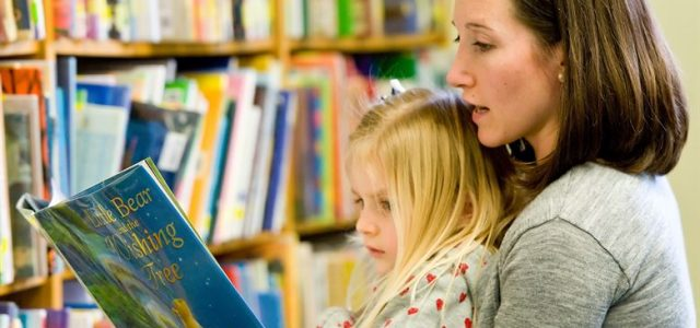 mother-reading-to-a-girl