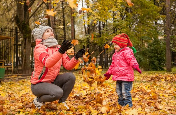 mother-and-daughter-happy-in-the-autumn-leaves