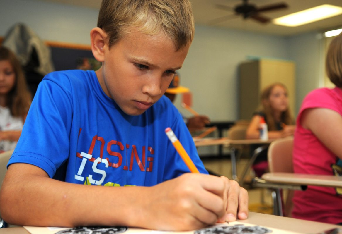boy-writing-with-a-pencil
