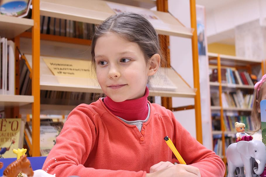 girl-writing-in-a-library