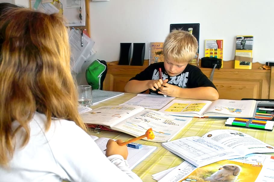 boy-studying-with-a-teacher