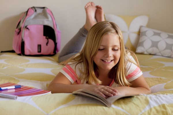 girl-reading-and-smiling