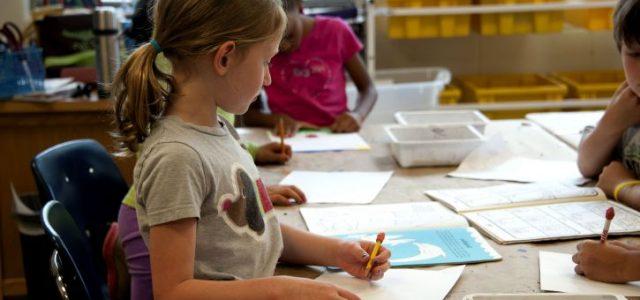 girl-drawing-in-school